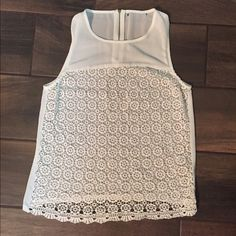 White Lace/Crochet Tank Gold zipper in back. I cut the tag out because it was itchy but I am 100% sure of the brand and size, no worries! Such a fun summer top. Forever 21 Tops Tank Tops