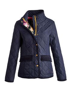 Joules Womens Quilted Jacket , Marine Navy.                     It's back and better than ever! With new details to give it an even more stylish look and feel, our favourite quilted jacket has been given a new lease of life. The traditional diamond quilt remains and on the side panels you'll noticed we've shrunk the size of them to give the appearance of a very complementary shape. Finished with a stunning printed lining and authentic brass poppers.
