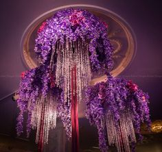 A trio of purple orchid floral designs. Planning:Frank Event Design #lighting