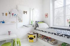 Bed with toy storage. Great idea for a future child's room!
