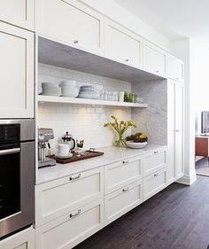 Mandy Milk's olive and white kitchen from House and Home {love the subway tile behind the shelves + BM Dark Olive painted lower cabinets} One Wall Kitchen, New Kitchen, Kitchen Dining, Kitchen Decor, Wall Of Kitchen Cabinets, Shelves In Kitchen, Kitchen Feature Wall, Kitchen Drawers, Kitchen Modern