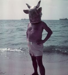 Artist Pablo Picasso wearing a cow's head mask on beach at Golfe Juan near   Vallauris.