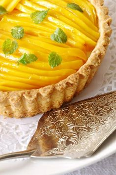 Mango Cream Pie.   This makes me want to make a mango+sticky rice inspired tart with coconut cream filling and a gluten free crust.
