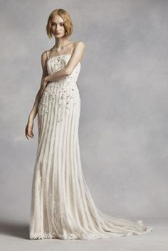 Simple yet stuning, thisbeautiful sheath wedding dresswill be one to remember!  Fitted gown with vertical bias-cut strips and lace underlay.  Spaghetti straps addslight detailandcoverage to shoulders.  Dress details include allover beaded lace scattered with crystal and pearls.  Sizes 0-14. Available onlineonly in Ivory/Champagne.  Fully lined. Zipper back. Imported polyester. Dry clean.  To preserve your wedding dreams, try our Wedding Gown