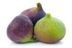 Image of 'Ripe purple and green fig fruit isolated on white background'