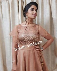Stunning Anchor Syamala in Swathi Veldandi. Beautiful designer skirt and crop top with hand embroidery stone work on yoke. Crop top with bell sleeves.   23 January 2019