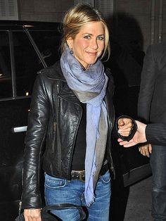 Jennifer Aniston in a blue & gray scarf.