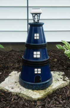 My clay pot Lighthouse Clay Pot Projects, Clay Pot Crafts, Clay Flower Pots, Flower Pot Crafts, Solar Light Crafts, Solar Lights, Clay Pot Lighthouse, Painted Clay Pots, Pot Lights