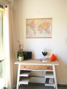 cheap way to hang a map, rather than framing. glue dowel rods and add string to hang