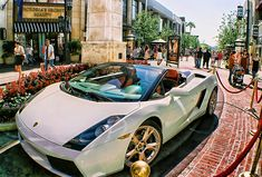 White Lamborghini w/ gold rims and a red/black interior with removable (or however you say it) roof top. YES! :)