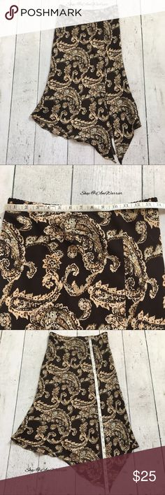 "Silk asymmetrical paisley print skirt Gorgeous cocoa brown silk skirt with paisley print. Elastic pull up style. Slid split with asymmetrical 'tail' detail on front. Approx 14"" unstretched across waist. Longest front tail is just shy of 34"", shorted length is approx 27"" long. Very flattering on. Good condition with the exception of a couple tiny snags. Please read my bio regarding closet policies prior to any inquiries. Merona Skirts Asymmetrical"