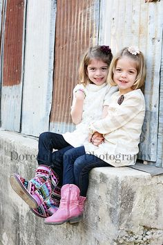 Such cute sisters! Love their outfits.