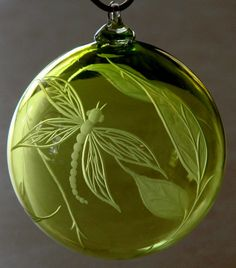 *Dragonfly Ornament*Hand engraved glass ornament  by Catherine Miller of Catherine Miller Designs.* Technique-Stone wheel.*Lime green Ornament