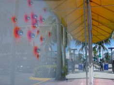 SuperPOX installation. With neon Orange and Pink background. ArtCenter South Florida display window, LMNOQ