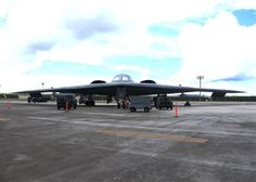 Airmen from the 509th Aircraft Maintenance Squadron work on a B-2 Spirit bomber during a deployment Aug. 22, 2014, at Andersen Air Force Bas...