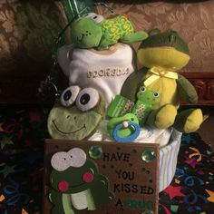 Unisex frog diaper cake Stuff frog Onesie Frog nail clipper Frog rattle toy Frog cold compress Pacifier Bottle Receiving  blanket Frog picture Frog wind chime  Diapers  Will be wrap in plastic with bow Other