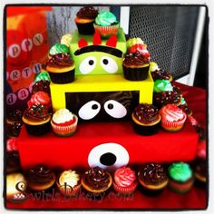 Love the idea of cardboard boxes covered to make display for cupcakes! Yo Gabba Gabba Birthday Party!