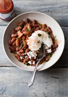 Traditionally, New Orleans' famous red-beans-and-rice dish was something you ate on Mondays, since that was usually laundry day, when no one had time to cook. We'd happily hunker down with a bowl of fluffy white rice and creamy, meaty red beans any day, though. The dish takes on a smoky taste thanks to a ham hock, which you simmer with the beans (there's also chili powder, thyme and bay leaves, as well as chopped bell pepper and celery). Dash of hot sauce on top? Don't mind if we do.