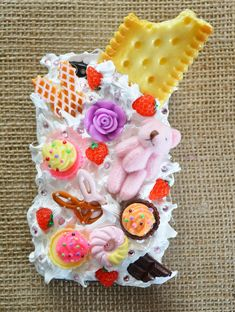 a phone case you done mind covering with frosting (we got a pack of 4 clear iPhon