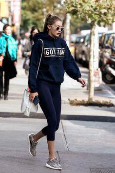 Gigi Hadid wearing  Sicky Eyewear CS X S10 Sunglassed, Gotham Gym Original Gotham Gym Hoodie, Tom Ford Leather Small Tassel Bucket Bag, Adidas Woman's Yeezy 350 Boost Sneakers