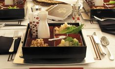 Bento boxes at each place setting for Passover - like a personal Seder plate