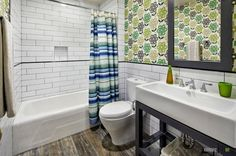 An astounding bathroom with sweet green flowery wall idea and brick tile combination with buitl in bathtub and simply white sinks