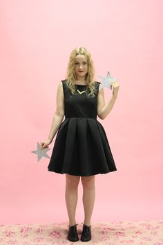 Darling London Sasha Dress in Black. This perfect little black dress is just BEYOND! The super flared and pleated skirt is so 1950s! The finishing touch is a great big bow across the back shoulders! Available at www.victoireboutique.com and its on sale!
