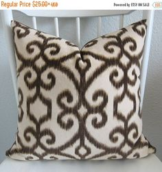 ONE pillow cover.  We used a home decor fabric Top Kapi Fawn.  Contents: 100% polyester  Colors: creamy ivory and brown. SAME FABRIC on BOTH SIDES.  Zipper closure. Pattern placement may vary.  Dry clean recommended.    All edges are professionally over locked to prevent fraying.  All materials used are top quality home decor fabrics. Please let me know if you have any questions.    Thanks for visiting my shop. New pillows are added daily. Check back soon for new designs.