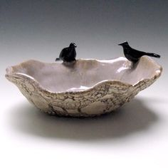 I love ravens in any motif, and this beautiful piece of hand-crafted pottery is exquisite.  Definitely one of my craveables ... -- Eve.
