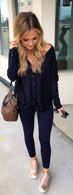 #spring #outfits  woman wearing black button-up shirt and black pants holding sunglasses and carrying Louis Vuitton bag. Pic by @thestyledduo