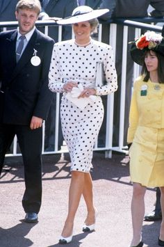 DIANA, PRINCESS OF WALES  Year Inducted: 1989 - Style Hallmarks: The first stylish royal since—what, when Elizabeth I's ruff collars were sweeping England?—Diana made a behatted splash on the scene with coordinating, tailored ensembles, fabulous gems, and her signature short haircut. She's seen here in black-and-white polka dots at 1988's Royal Ascot.