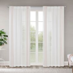 The Ivy Border Embroidered Window Sheer provides a light and airy vibe, perfect to soften your décor. The lightweight sheer fabric features an embroidered border design, framing your window for elegant appeal. Simply hang with the rod pocket top or back tabs for a tailored look. These sheer panels softly filter the perfect amount of light into your home, creating a new dreamy scene in your room.