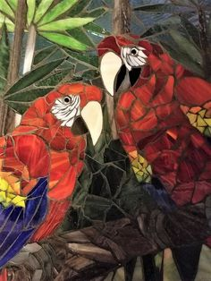 Scarlet Macaws done in stained glass. Marlene Outlaw, mosaic artist.