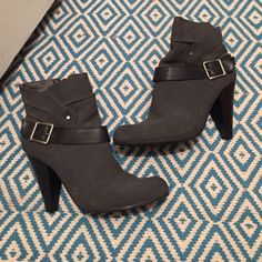 Heeled booties Gray and black heeled booties with black straps around the ankles. Shoes Ankle Boots & Booties