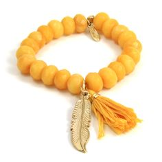 Yellow Elastic Bracelet with Tassel and Gold Feather Charm $75