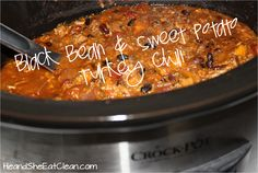Take a little bit of time to slow cook a pot of crock pot black bean and sweet potato chili. Your family will thank you! Get the recipe on HeandSheEatClean.com. #heandsheeatclean #eatclean #chili #crockpot #healthy