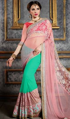 Be the picture of ethereal perfection in this rose pink and sea green color georgette net half n half sari. The lovely lace, resham, sequins and stones work a intensive element of this attire. #georgettesarees #nethalfnhalfsari #eveningwearsaree