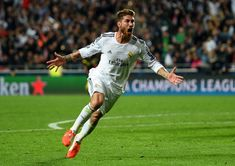 Sergio Ramos Photos - Sergio Ramos of Real Madrid celebrates scoring their first goal in stoppage time during the UEFA Champions League Final between Real Madrid and Atletico de Madrid at Estadio da Luz on May 24, 2014 in Lisbon, Portugal. - Real Madrid v Atletico de Madrid - UEFA Champions League Final