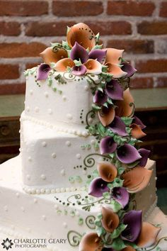 Wedding cake with purple and orange sugar calla lilies
