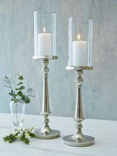 Elegant & sophisticated, these tall aged silver candle hurricanes are a stunning style statement.
