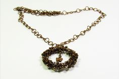 CopperJEWEL woven brass wire pendant and chain necklace.
