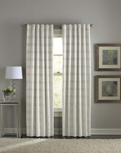 (room darkening curtain) I don't understand how these attach to rod.  clearly not just standard pocket - clean look, no hooks, more modern, ceiling flush
