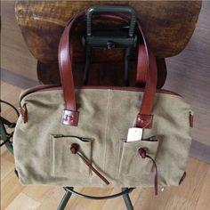 "GUCCI Safari Handbag Shoulder Bag NWT GUCCI canvas casual shoulder bag Handbag. Color KHAKI. Condition NWT. Leather handles and detail. Measurements 15""(l)x9""(h)x3.5""(depth at widest ). Made in Italy. Purchased at Bergdorf Goodman NYC. No dust bag Gucci Bags Shoulder Bags"