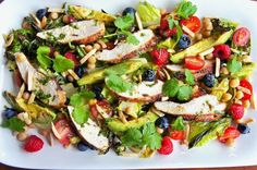grilled chicken salad with berries and avocado.