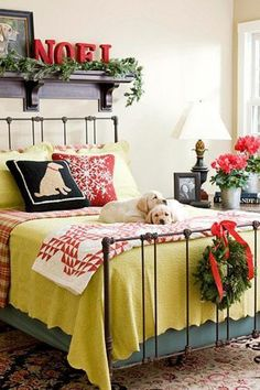 """Pinboard """"Bedrooms"""" by Jackie Batchelor has a wonderful collection of shabby chic and country bedrooms.  Shown - Black iron bed, red and white check spread, yellow bedcover, white with red quilt, green wreath tied with red ribbon to foot of the bed, table with white containers and red geraniums,"""