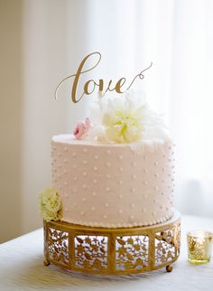 Pretty laser cut cake topper: http://www.stylemepretty.com/2016/05/19/classic-nautical-nantucket-wedding/ | Photography: Lacie Hansen - http://laciehansen.com/