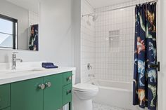 Colorful cabinets and playful shower curtain brighten this beautiful guest bath. Custom Home Builders, Custom Homes, Dream Home Builder, Bath Design, Guest Bath, Luxury Homes, Cabinets, Bathrooms, Colorful