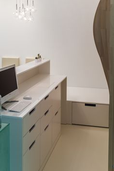 minimalist white reception, countertop from glossy white MDF, back doors from melaminated PAL orders/price offers at: office
