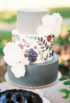 A Three-Tiered Modern Floral Wedding Cake. Working with stationer Caroline Curtin McGah of Lovely Paper Things, cake designer Lindsey Stone of S'more Sweets Bakery transformed one of Caroline's floral paintings into an edible work of art by printing it directly onto wafer paper. | via Brides.com