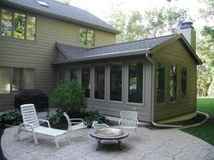 Sunroom addition with patio - not sure if I'd rather have a patio or deck attached to the addition...
